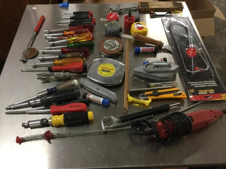 A large selection of tools. Nut drivers, screwdrivers, tape measures, more