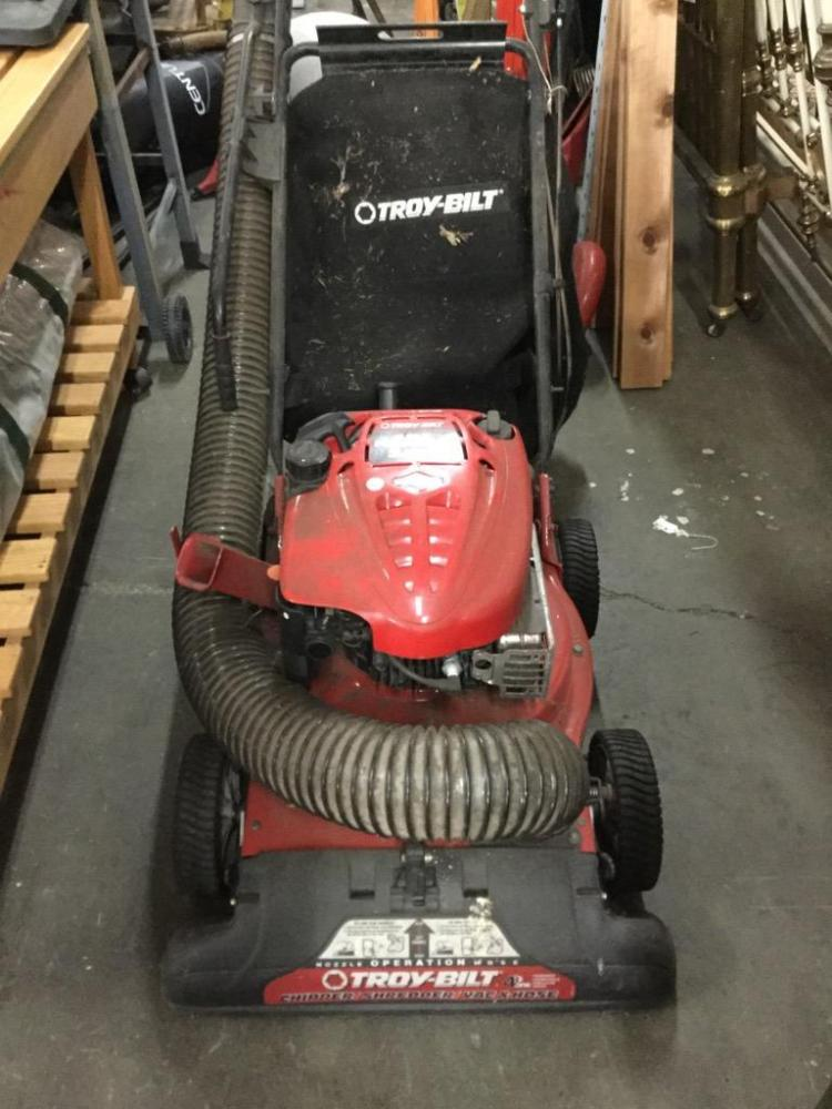 A Troy-bilt 5.5 H.P. Mower / mulcher w/ bag. Needs work