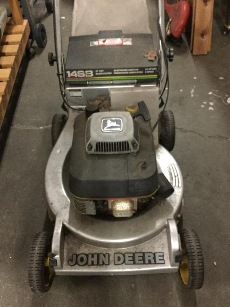 A John Deere self propelled lawnmower w/ bag. Needs work