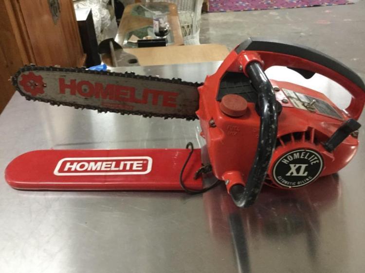A Homelite XL chainsaw w/ a 14