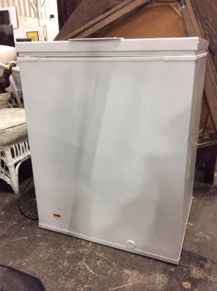 A Frigidaire small chest freezer