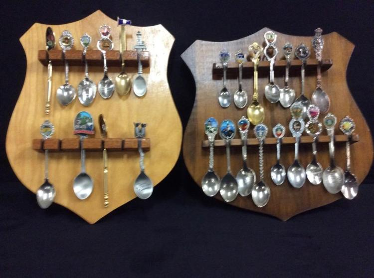 2 sets of collectors spoons and shield displays