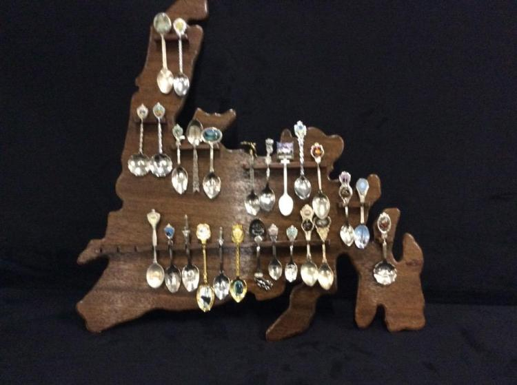 Collection of collectors spoons on display