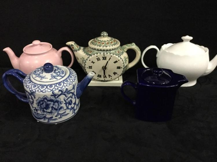 Collection of modern teapots - includes teapot with clock on it!