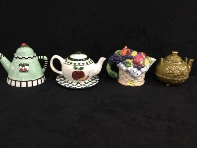 Set of four fruit themed Teapots