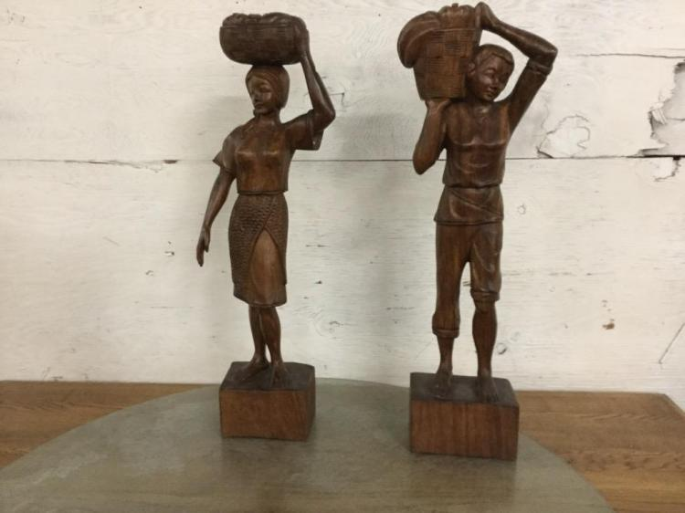 Set of two carved indonesian/islander statues - solid wood