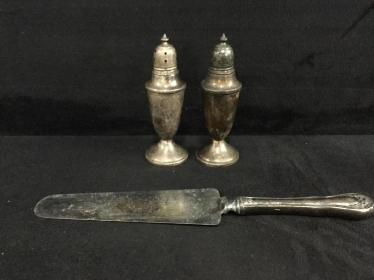 Sterling Silver salt and pepper shakers and handled knife