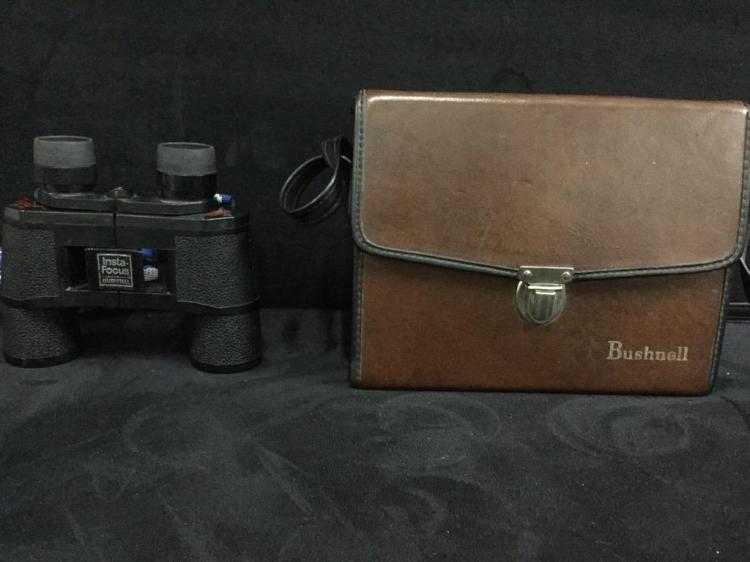 Pair of Bushnell Binoculars - one with case