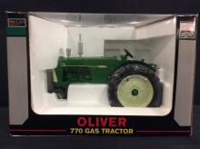 Oliver 770 gas tractor by SpecCast, NIB 1:16 scale.