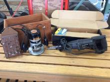 A Craftsman electric router w/ bits and a Craftsman sawzall