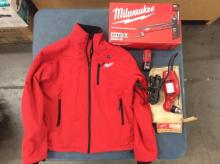 A Milwaukee large heated jacket, a reversing drill and a cordless multitool kit, all like new
