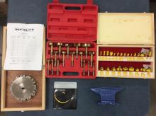 A Infinity dado set, a Mastergrip Bit set, a Woodtek bit set, and a small anvil, all new