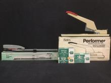 the performer heavy duty stapler, and a swingline long reach stapler, both brand new