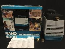 A Rand 4000 HP air compressor, lightly used w/ original box.