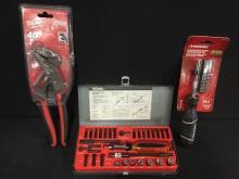 a ratchet driver set, milwaukee groove pliers, and a Husky screwdriver set, all brand new