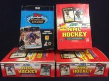 4 NHL Hockey collector card dealer boxes. 1991 Topps stadium club, 2 1991 Score Bilingual &1 English