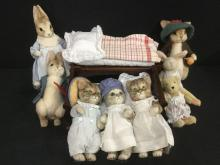 Large set of Beatrix Potter stuffed toy figures and Muffy Dolls crib