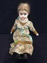 Vintage hand painted bisque porcelain doll in good condition