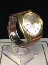 a Vulcain cricket wristwatch, self winding, works great