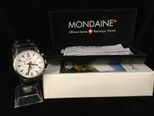 a Swiss made Mondaine chronograph wrist watch new in original box.