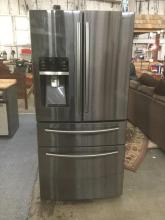 A new Samsung French door refrigerator in black stainless steel
