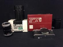 A Canon FTb 35mm camera body, a 100mm telephoto lens, and a Canon waist level viewer.