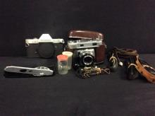 A Rolleiflex SL35 camera in parts, A Kodak Retina 35mm IIIc, and misc. leather straps