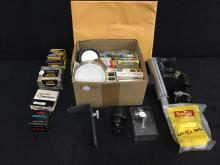 A large collection of Camera lens filters and accessories.