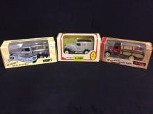 2 model car coin banks and 1 Hershey's model pick up truck