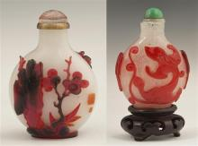 Chinese Red Glass Overlay Snuff Bottle, early 20th c., with landscape and figural decoration, and relief chopmarks, with an orange s...