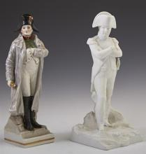 Two German Napoleon Figures, 20th c., one of polychromed porcelain, the other of white bisque, Bisque- H.- 8 1/2 in., W.- 3 3/4 in.,...