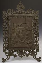 Continental Tri-fold Brass and Iron Vanity Easel Mirror, 19th c., with a pierced frame with a mask surmount, the front panel with a...