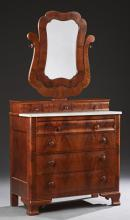 American Classical Carved Mahogany Marble Top Dresser, 19th c., the large shaped mirror on conforming yoke, on a bank of three drawe...