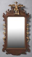 American Federal Style Carved Giltwood Mirror, early 20th c., with an eagle surmount over pierced scalloped sides with giltwood flor...