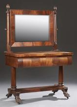 American Classical Revival Carved Mahogany Dressing Table, 19th c., the rectangular mirror on turned supports to a black glass top o...