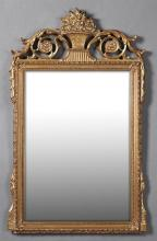 Carved Gilt and Gesso Overmantel Mirror, 20th c., by John Richard, the pierced floral backet crest over a wide beveled plate within...