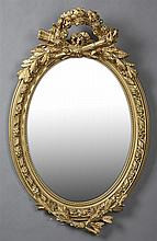 French Louis XVI Style Gilt and Gesso Overmantel Mirror, c. 1900, with a pierced torch, quiver and floral garland crest around a wid...