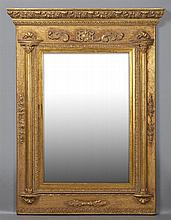 French Style Gilt Composition Wood Overmantel Mirror, 20th c., the relief ogee crown over an acanthus relief frieze above a wide bev...