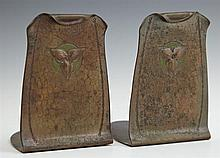 Pair of Roycroft Arts and Crafts Hand Hammered Copper Bookends, c. 1905, with repousse floral decoration, H.- 5 1/8 in., W.- 3 1/2 i...