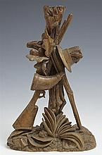 Black Forest Carved Walnut Candlestick, 19th c., in a hunting motif with gun, hat, and walking stick, H.- 9 1/4 in., W.- 6 in., D.-...