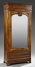 Louis XIII Style Figured Rosewood Armoire, late 19th c., the ogee cornice above an applied frieze over a stepped edge to a single ar...