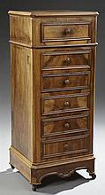 Louis Philippe Style Carved Walnut Nightstand, early 20th c., the canted stepped edge walnut top over a frieze drawer, a faux two dr...