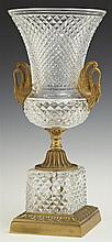 Sevres Crystal and Bronze Empire Style Vase, 20th c., with swan's head handles on a relief bronze socle support to a crystal plinth...