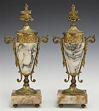 Pair of Marble and Gilt Spelter Handled Urn Garnitures, late 19th c., the highly figured tapered ocher marble bodies with covers wit...