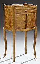 French Louis XV Style Inlaid Cherry and Mahogany Nightstand, early 20th c., the crotched top surrounded by a scalloped three quarter...
