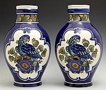 Pair of Royal Copenhagen Aluminia Faience Baluster Vases, 20th c., with leaf banded necks and reserves of parrots, on a blue ground,...