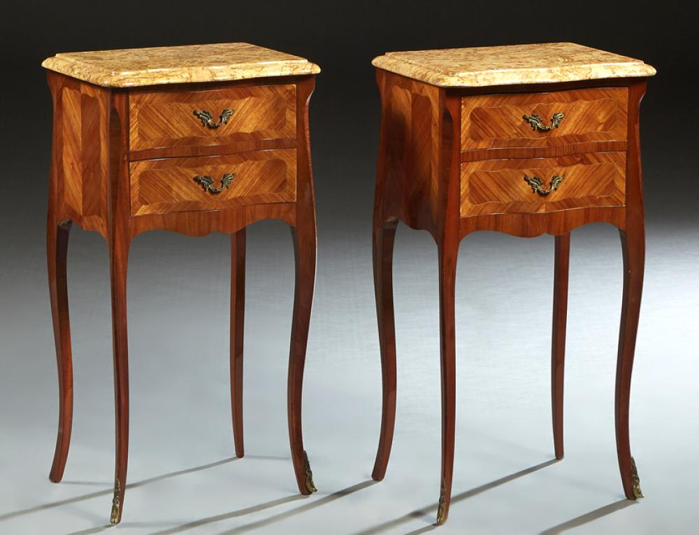 Pair of French Inlaid Mahogany Louis XV Style Marble Top Nightstands, 20th c., the sloping edge bowed rounded corner figured ocher m...