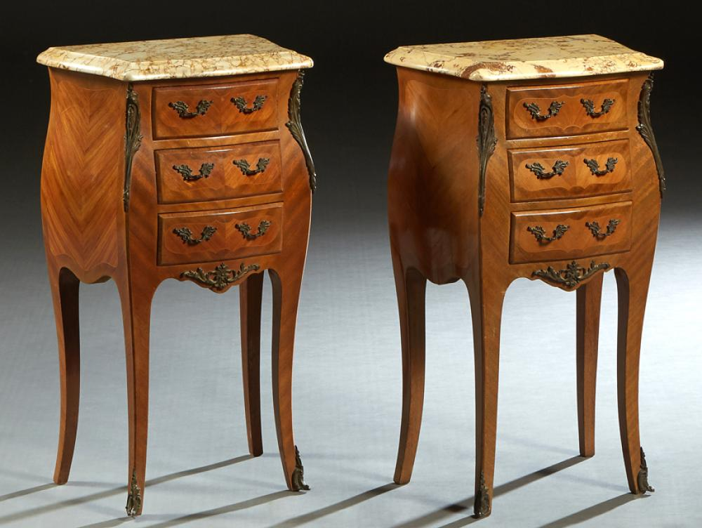 Pair of Louis XV Style Carved Mahogany Marble Top Bombe Nightstands, 20th c., the shaped beveled edge ocher marble over a bank of th...