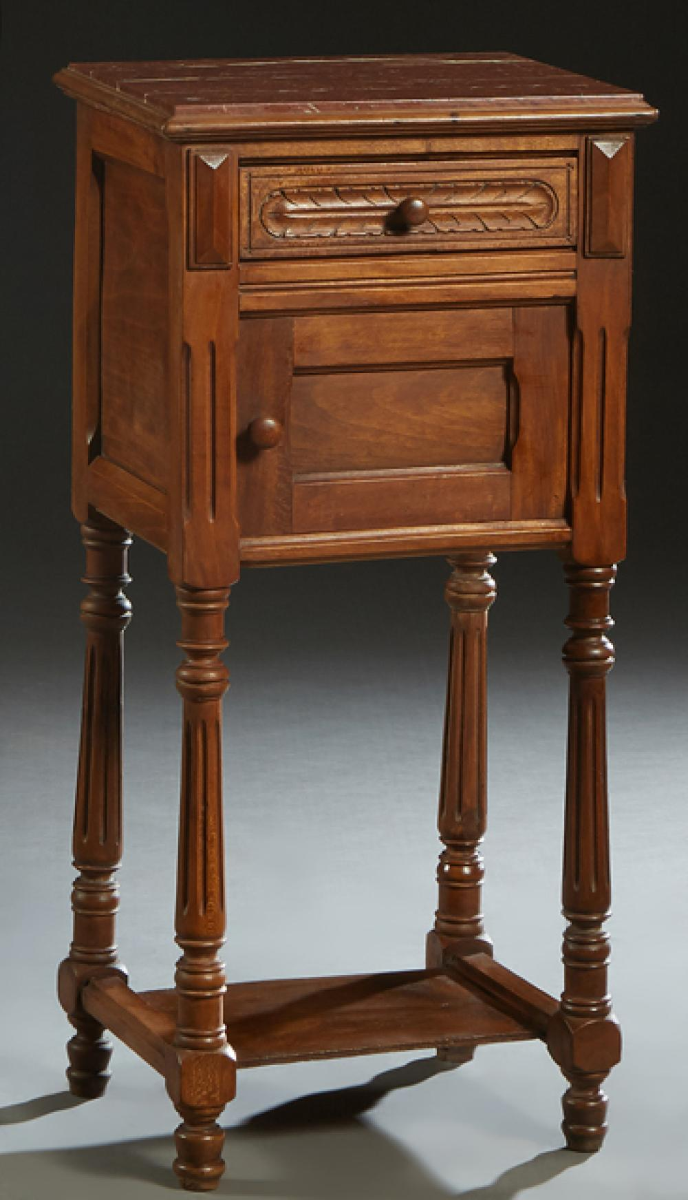 French Henri II Style Carved Walnut Marble Top Nightstand, late 19th c., the inset highly figured rouge marble over a frieze drawer...