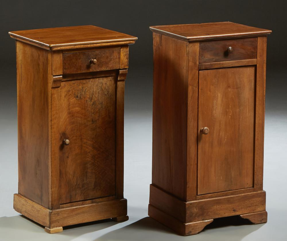 Near Pair of French Louis Philippe Style Carved Walnut Nightstands, late 19th c., the rectangular top over a frieze drawer, and a lo...